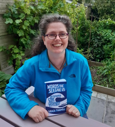 Grace And Book In Garden Portrait E1612908462530